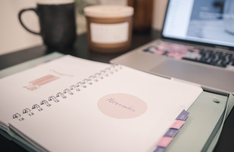 planner on table opened up to November 2020 plan with me blog by Nicole Eva