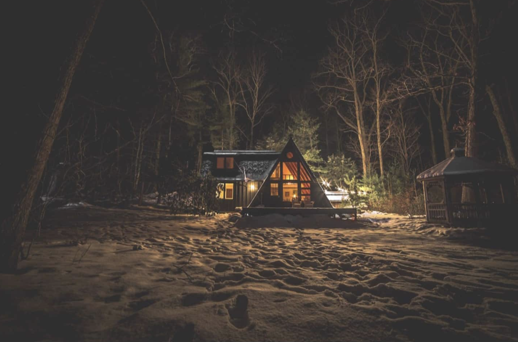 A black a frame sustainable Catskills cabin from airbnb for 8 airbnb locations I would visit right now by Nicole Eva