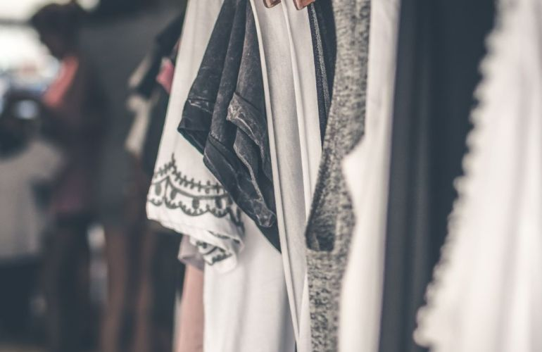 clothes hanging in a wardrobe for post late 20s look book about fashion in your late 20s